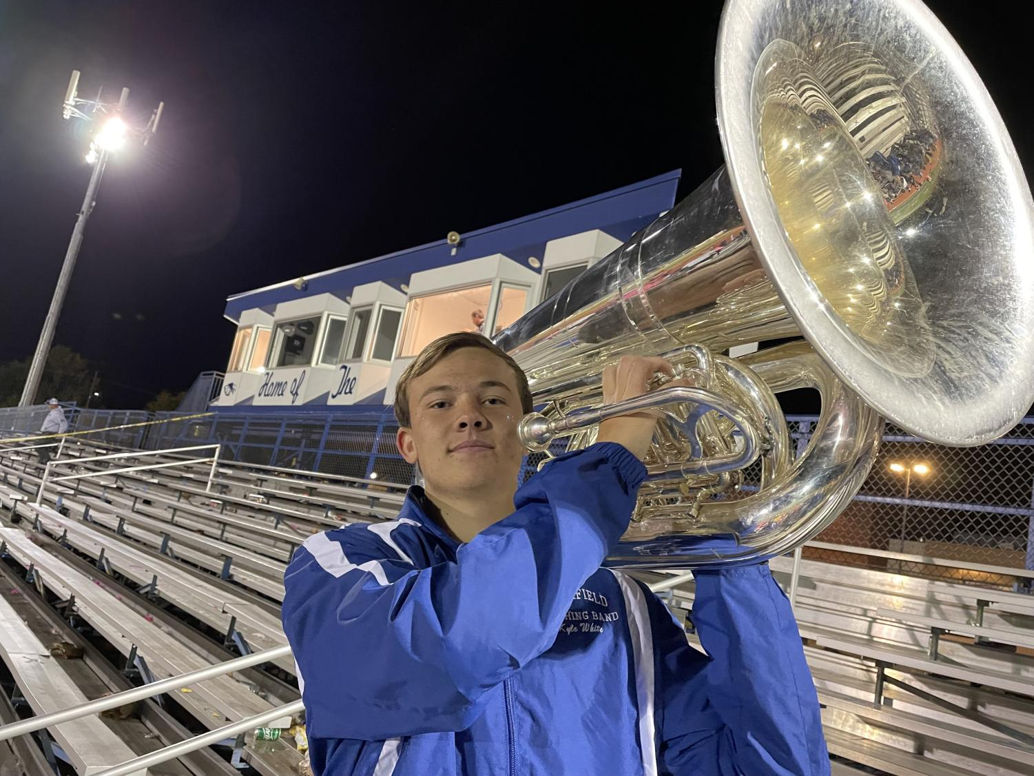 Deep Tones Kyle poses for a photo with his massive instrument before a home football game.