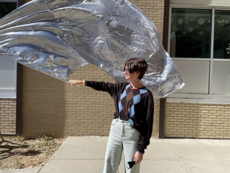 Maya Oakley holds a color guard flag.